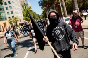 Anti-fascist counter-protestors parade through Sacramento after multiple people were stabbed during a clash between neo-Nazis holding a permitted rally and counter-protestors on Sunday at the state capitol in Sacramento, California, United States, June 26, 2016. REUTERS/Max Whittaker