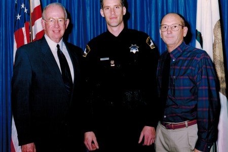 Sheriff Glenn Craig (L), me, and my dad (R) the day I got sworn in as a full-time deputy.