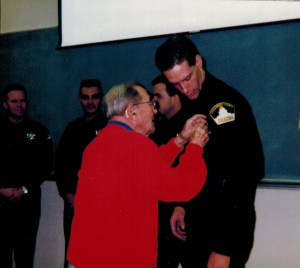 My 96 year old grandfather pinning my badge on me when I got sworn is an an-call deputy